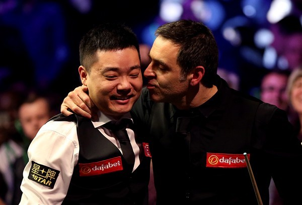 Ding and O'Sullivan embrace (credit:Steven Paston/PA Images)