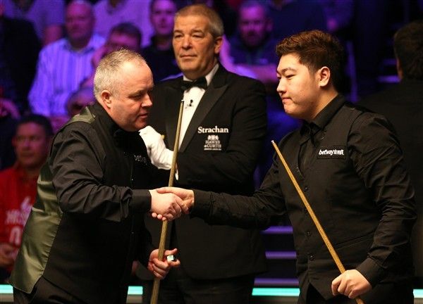 Higgins shakes hands with Yan (credit:Nigel French/PA Images)