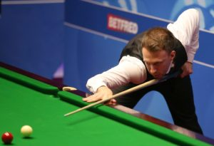 Judd Trump scrapes through at the English Open as Higgins and Wilson progress