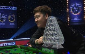 Brilliant Yan Bingtao denies John Higgins to claim historic Masters title